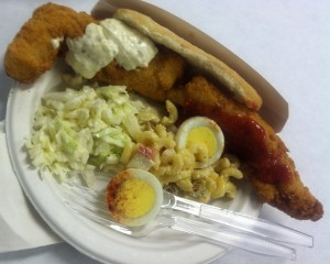Fried pollack with sides of slaw and macaroni salad