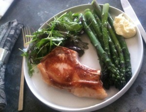 Pastured pork chop, zesty greens, fresh asparagus